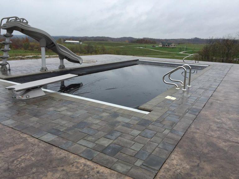 Backyard pool with pool cover