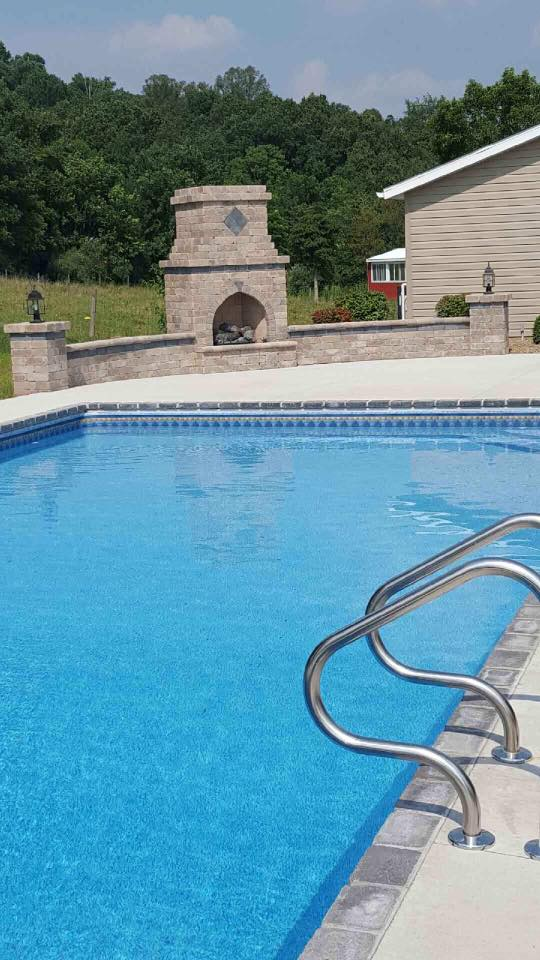 Outdoor pool with fireplace