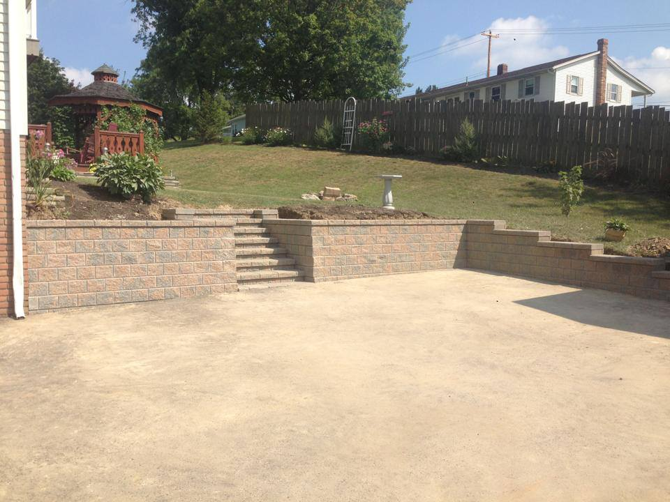 Stone wall with parking pad