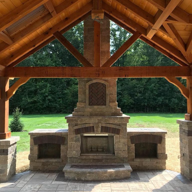 Outdoor fireplace with two cubbyholes and cool brick pattern